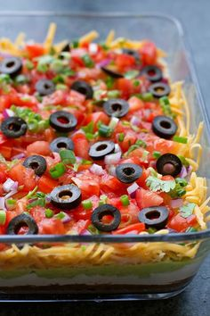 Best ever 7 layer dip! It's colorful, flavorful and perfect for game day, parties or BBQs! It only takes a few minutes to make and even less time to devour.