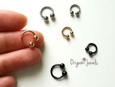 ♣ Free shipping on any additional items This listing is for one horseshoe barbell earring with inner diameter options of roughly 6mm (1/4) and 8mm (5/16). Simple and classy, these barbells are fabulously wearable on 16ga piercings of nose, ears and lips. O P T I ON S : 6mm (1/4) with 3mmx3mm ball ends 8mm (5/16) with 4mmx4mm ball ends  Available in black, gold and silver ♣ Nickel free, Hypoallergenic Earring  ••••••••••••••♣••••••••••••••  THANKS FOR VISITING OUR SHOP