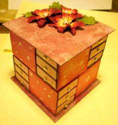 I set the challenge to make a Matchbox advent calendar. This consists of 24 matchboxes - surprise, surprise covered in paint, paper and dist...