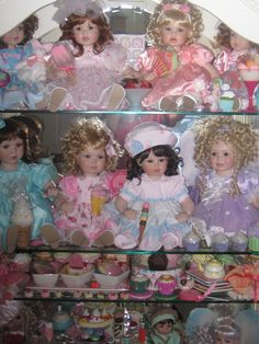 Curio with Pink Parfait, Harmony, Satin, Whipped Cream re-dressed and Harmony Butterfly. Marie Osmond dolls.