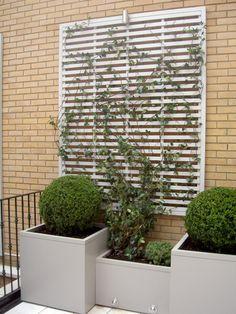 Bespoke grey planters and slatted panel