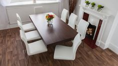 Dark Wood Veneer Dining Table and White Dining Chairs
