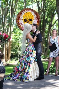 The dress is beautiful. A good example of a colorful, wedding dress done well.