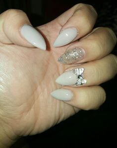 Stiletto Nails, Glitter, Gel and  crystal bow