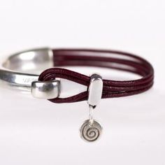 Poppy | Wristicuffs Handmade European leather half and half bracelet with spiral charm.  Custom made to order from a large color selection.  #handmade #leather #bracelets #cuffs #charms #armparty #armcandy #wristicuffs Women's Bracelets, Leather Bracelets, Labyrinths, Arm Party, Spirals, Handmade Leather, Poppy, Cuffs, Charms