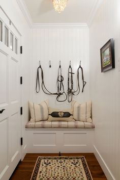Equestrian farmhouse. Love the bridles hanging in the background.