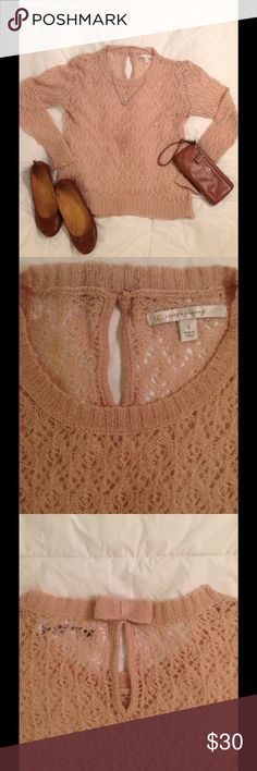 🎀 Lauren Conrad knit sweater 🎀 This delicate knit sweater in a dusty rose pink color is sure to catch anyone's eye! It is very soft and it's light weight material makes it perfect for spring. It has a sweet key hole opening with a bow in the back at the neck. Size small. Pairs well with fitted jeans and flats. One of my favorites! 🙂 LC Lauren Conrad Sweaters Crew & Scoop Necks