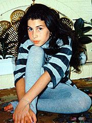 """At 12, Winehouse wins a space in the prestigious Sylvia Young Theatre School, but is expelled long before graduation. (The final straw? Getting her nose pierced). """"She was very bright but she was always messing around,"""" mom Janis tells London's Daily Mail in 2007. By 16, Winehouse – who later tells Interview, """"I'm not very ambitious at all"""" – lands a deal with Simon Fuller's (the man behind American Idol) management company. She eventually signs with Island Records."""