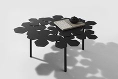 """Table """"Autumn""""  The main objective of creation of the table was to depict usual process of nature as well as autumn leaf cover in a static object. Each leaf is a stylized element, based on the geometric shape of cells. The elements are made of sheet steel by laser cutting. Details are interconnected at the bottom of the table top, thus they hide all the nuances of technical intervention."""