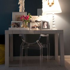 Parsons Desk, ghost chair, glass bubble lamp, and white mirror