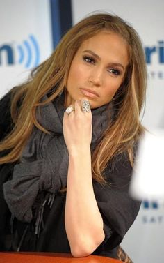 J Lo..why is her arm significantly lighter than her face??
