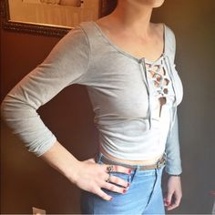 ❄️Gray Lace Up Crop Top S❄️ Super cute and trendy gray lace up crop top NWT! Has a low back. And you can adjust the ties to make them looser or tighter to accommodate your chest size. Great quality and fit! (not Nasty Gal just listed for exposure) I have two of these so please do not buy this listing! I'll create a separate one for you Nasty Gal Tops