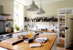 Ikea units with solid oak worktops - good idea.  Pendant lights also ikea.