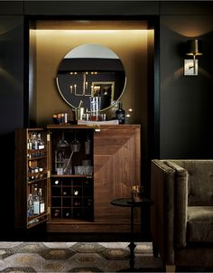 Parquet panels piece together gorgeous grain and color in this walnut bar cabinet that's ready to roll about the room for instant entertaining. With a flip and pull of the clean-styled brass hardware, the bar is open for business.