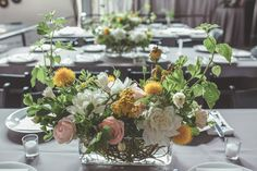 yellow, pink, and green centerpiece, photo by Hazelwood Photo http://ruffledblog.com/portland-wedding-with-music-inspired-details #weddingideas #centerpieces