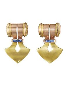 A Pair of Retro, Heavy 'Doorknocker', Gold and Sapphire Clips. Each designed as a polished gold shield-shaped clip, accented by square-cut sapphires, mounted in 14K rose and yellow gold.