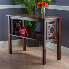 Features:  -Style: Contemporary.  -Solid wood in walnut finish.  Top Finish: -Walnut.  Base Finish: -Walnut.  Top Material: -Solid Wood.  Base Material: -Wood. Dimensions:  Overall Height - Top to Bot