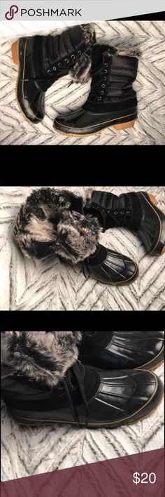 Khomeini rain boots w/interior fur Sorbs! Black statement Khomeini boots with gorgeous faux black and white fur! Good condition, very slight scuffing as they are used. Reasonable offers accepted✔️ Khombu Shoes Winter & Rain Boots