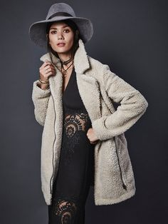 Teddy Coat   Super cozy and comfy oversized teddy coat featuring subtle embroidery detailing and soft micro-suede inside. Zipper closure with a hidden snap. Hip pockets.