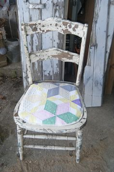 Very old weathered chair with vintage hand quilted padded seat!  So cute!