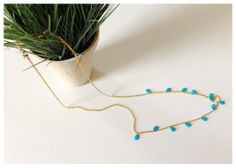 """Nothing like adding just a hint of color! Faceted turquoise teardrops accent this 36"""" gold plated cable chain."""