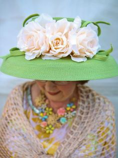 Linda Miedler in a pastel green hat color coordinating with the soft pastels in her outfit. May 2, 2014