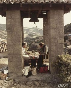"""Roger Moore and Albert R. """"Cubby"""" Broccoli behind the scenes on FOR YOUR EYES ONLY (1981) playing backgammon on location in the Meteora Mountains, Greece. #WorldTourismDay #BTS"""