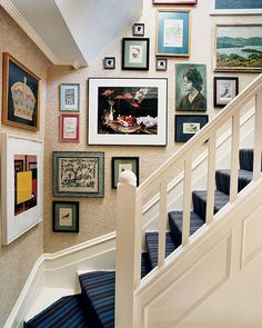 Consider making the hallway a family photo gallery with a large portrait the focal under the spot at the end of the hallway.