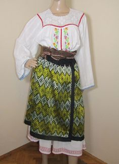 Gorgeous Romanian peasant costume from Oltenia. It contain 2 pieces: long antique dress and old pleated skirt.