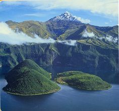 https://flic.kr/p/91eYPs | Cuicocha Lake, Cotacachi, Ecuador | AT 9,000 ft. elevation, Laguna de Cuicocha is in a caldera of an inactive     volcano.  The two island are a refuge for endangered plants and animals.