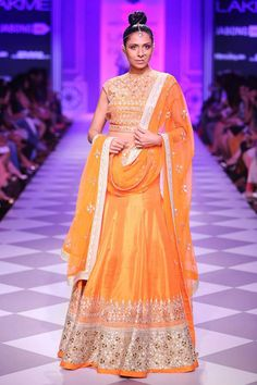 Orange traditional embroidery lehenga set available only at Pernia's Pop-Up Shop.