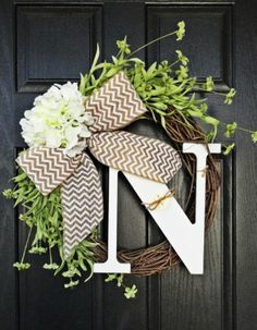 Housewarming Gifts for Newlyweds: Spring Monogram Initial Wild Flower and Hydrangea Front Door Wreath with Bow by Annabelle Eve Designs @ Etsy