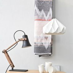 Snowpuppe Chestnut paper oragami lamp in white with grey/white cord