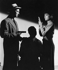 "A scene from ""High Wall"" 1947 film noir, directed by Curtis Bernhardt. Robert Taylor (left) and Audrey Totter"