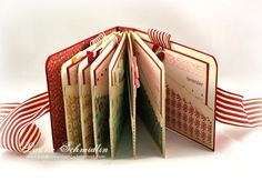 """pocket book: uses six 3 5/8"""" x 11"""" pieces of cream cardstock folded in half and adhered together to form slanted pockets for tags, photos, recipes, etc."""