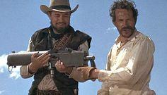 THE WILD BUNCH (1969) - Ben Johnson & Warren Oates discover a machine gun among stolen rifles - Directed by Sam Peckinpah - Warner Bros.