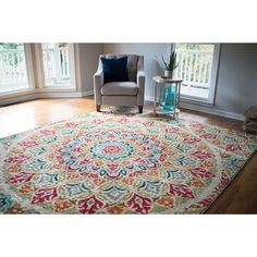 A pop of pattern and a variety of bright colors make this area rug a gorgeous addition to your home. The nylon construction of this rectangular area rug ensures this rug will resist stains and is resi