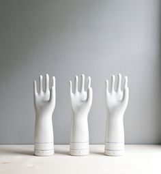 industrial porcelain glove mold:  don't they look eager? They have the answer.
