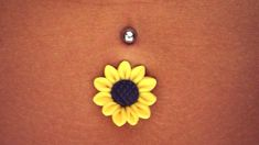 Sunflower belly button ring! I seriously have never been so in love!!!