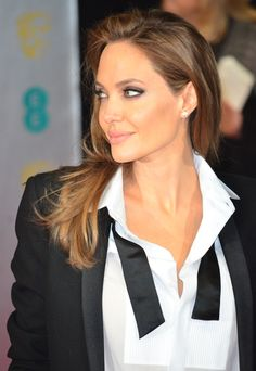 Awards season is here and we love Angelina's suit dressed with her sleek blowdried hair.