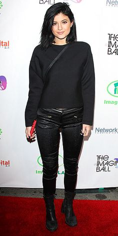 KYLIE JENNER It must have been unseasonably cool in West Hollywood for Kylie to cover up so much. Still the black sweatshirt, textured pants, motorcycle boots and cross-body bag she wore to The Imagine Ball are giving us some serious fall inspiration.