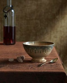 Still life with french bowl and bottle