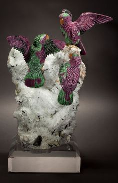 Lapidary Art:Carvings, PARROTS in RUBY & ZOISITE on ALBITE, MICA & TOURMALINEBASE. Artist: Peter Müller . Stone Source: for parrots:Longido...
