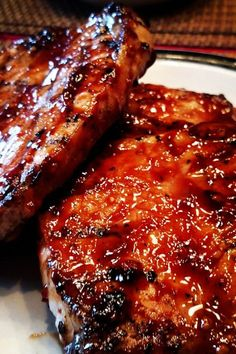 """World's Best Honey Garlic Pork Chops """"A quick and simple grilled pork chop that everyone will love featuring a simple and easy glaze."""" World's Best Honey Garlic Pork Chops – World's Best Honey Garlic Pork Chops Pork Chops And Rice, Honey Garlic Pork Chops, Honey Glazed Pork Chops, Smoked Pork Chops, Sweet And Sour Pork Chops, Brown Sugar Pork Chops, Traeger Pork Chops, Mexican Pork Chops, Pork Sirloin Chops"""