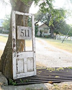 An old door posing as a house number frame... very cool! By Pennington Point via HomeTalk This would work for that old door... If I can fix it!
