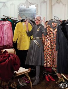 """""""I was one of the first New York women to wear boots,"""" says Apfel, who designed the gilt-leather-and-fabric pair on the floor at right. Racks of her vintage pieces fill a spare room; she is especially fond of the metallic-check coat by Galanos   archdigest.com"""