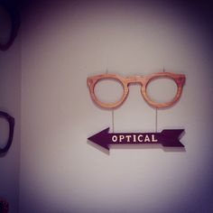 In need of signage? Have your Bespoke Sign made by Backyard Spectacles.This Canarywood P3 is on its way to a shop in San Degio. #display #glasses #optical #signage #eyewear.