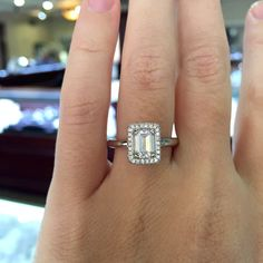 emerald cut halo diamond engagement ring in white gold