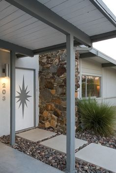 Here's a decorative front door mural that I painted for my vacation rental: Mid-Century Life.