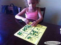 Math Jewel Game. This math game only costs $1 to make, is fun, and teaches many essential mathematical and learning skills. A great game to teach math to kids.